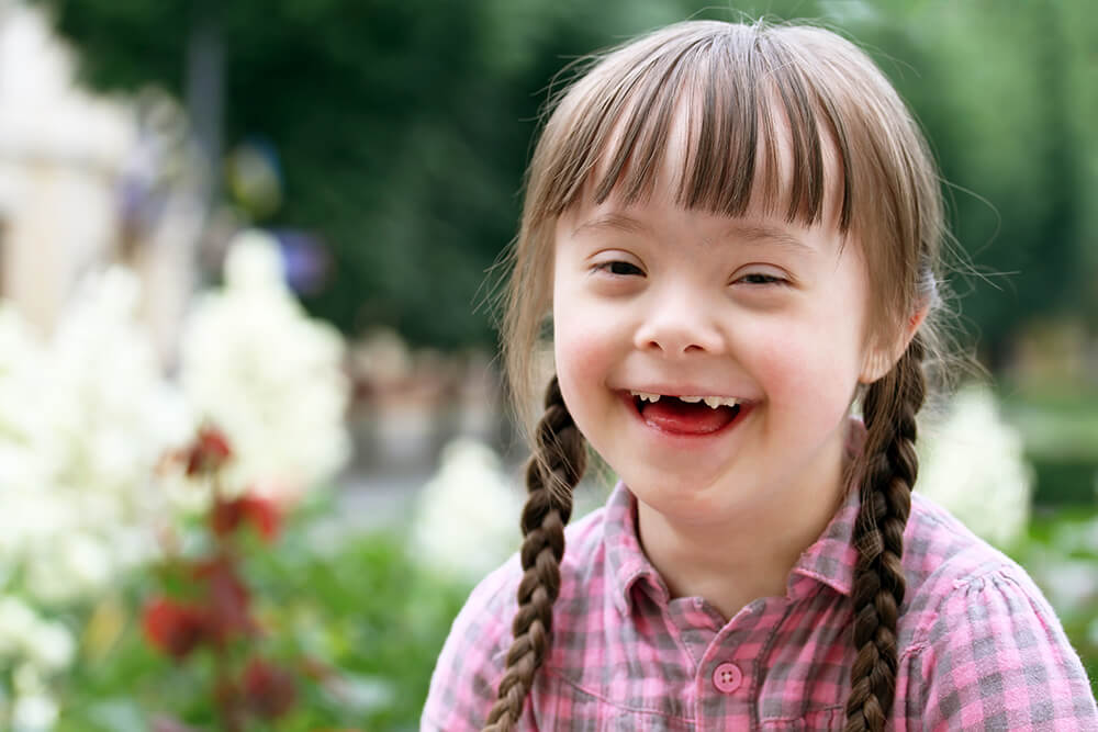 Smiling girl with Down syndrome