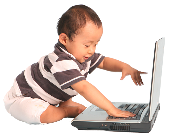 Toddler with autism sitting on the floor pushing the keys of a laptop