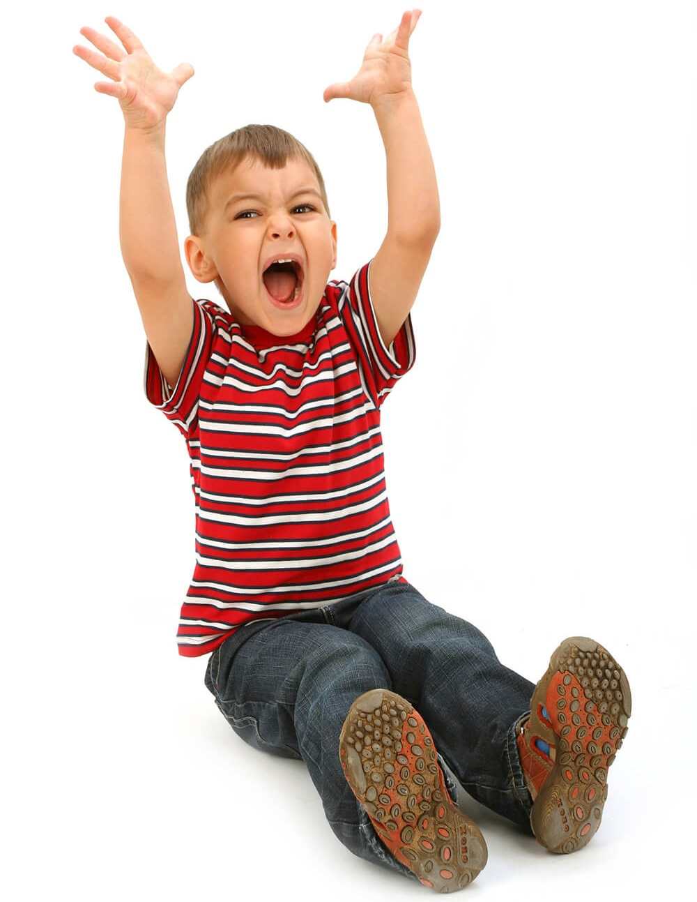 Upset boy with ADHD (Attention Deficit Hyperactivity Disorder) yelling with his arms in the air