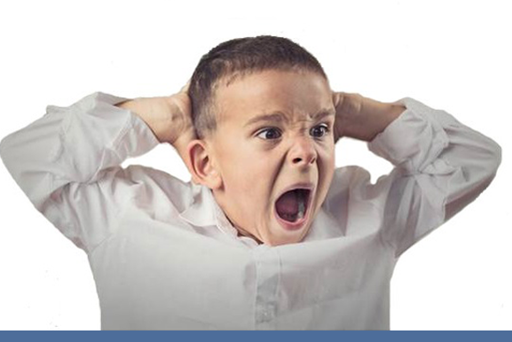 Tantrums – Boy with autism yelling and upset with his hands behind his head