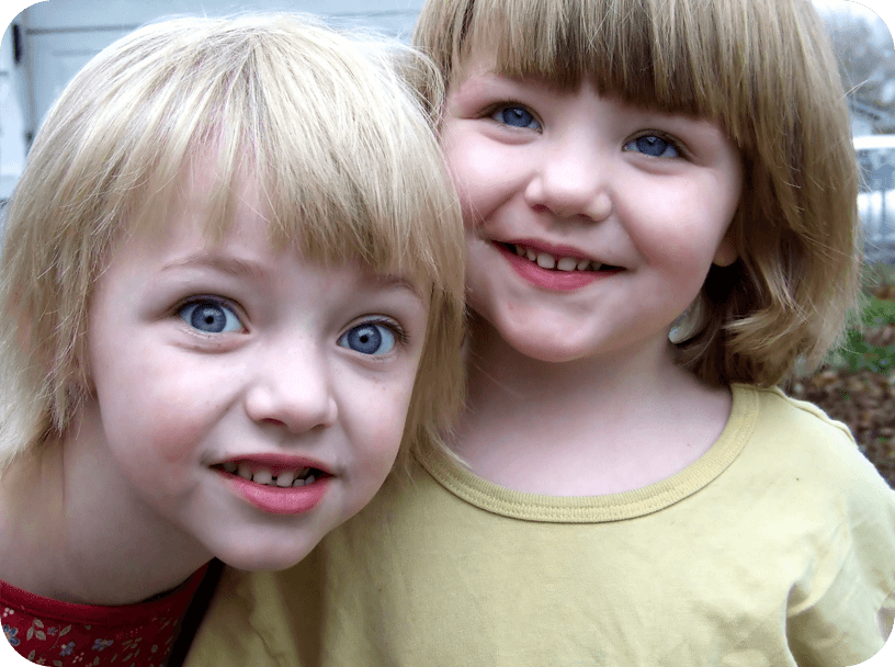 Two girls with disabilities other than autism, such as ADHD (Attention Deficit Hyperactivity Disorder), Down syndrome, Mental Retardation