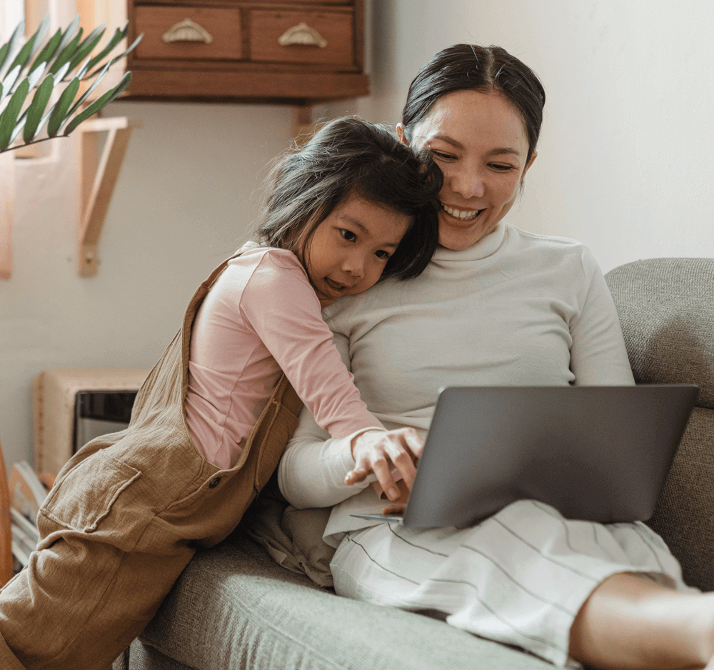 Mother with daughter on the autism spectrum, signing up for newsletter